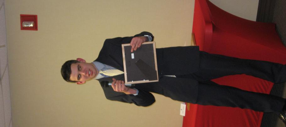 man with award and microphone